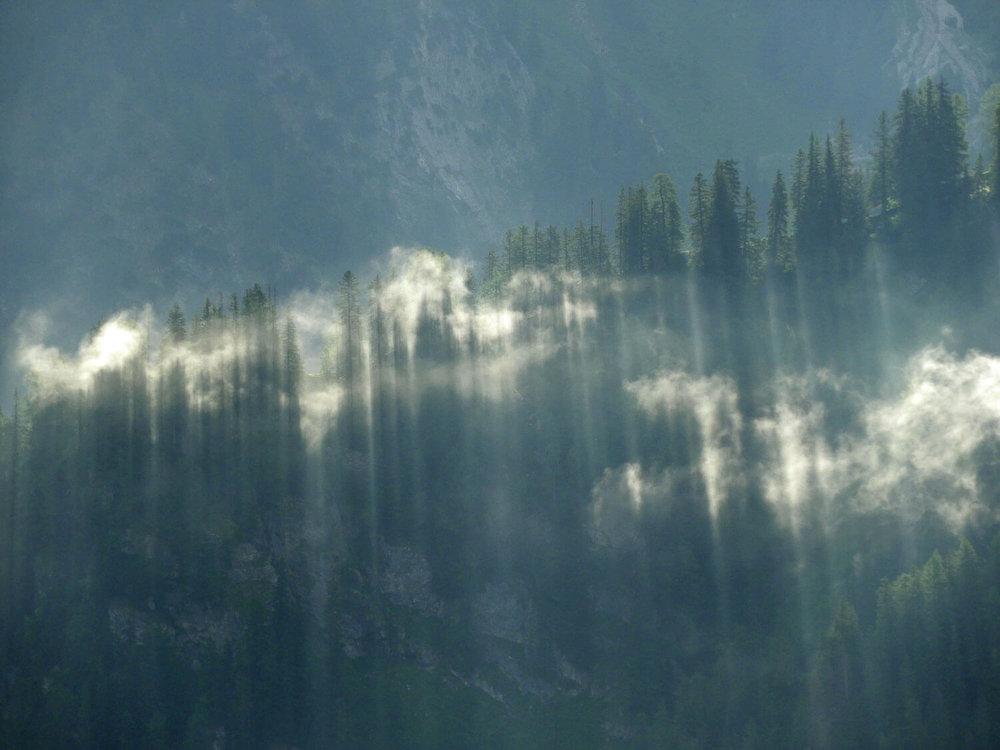 liechtenstein-malbun-hike-clouds-morning-sun-rays-trees.jpg