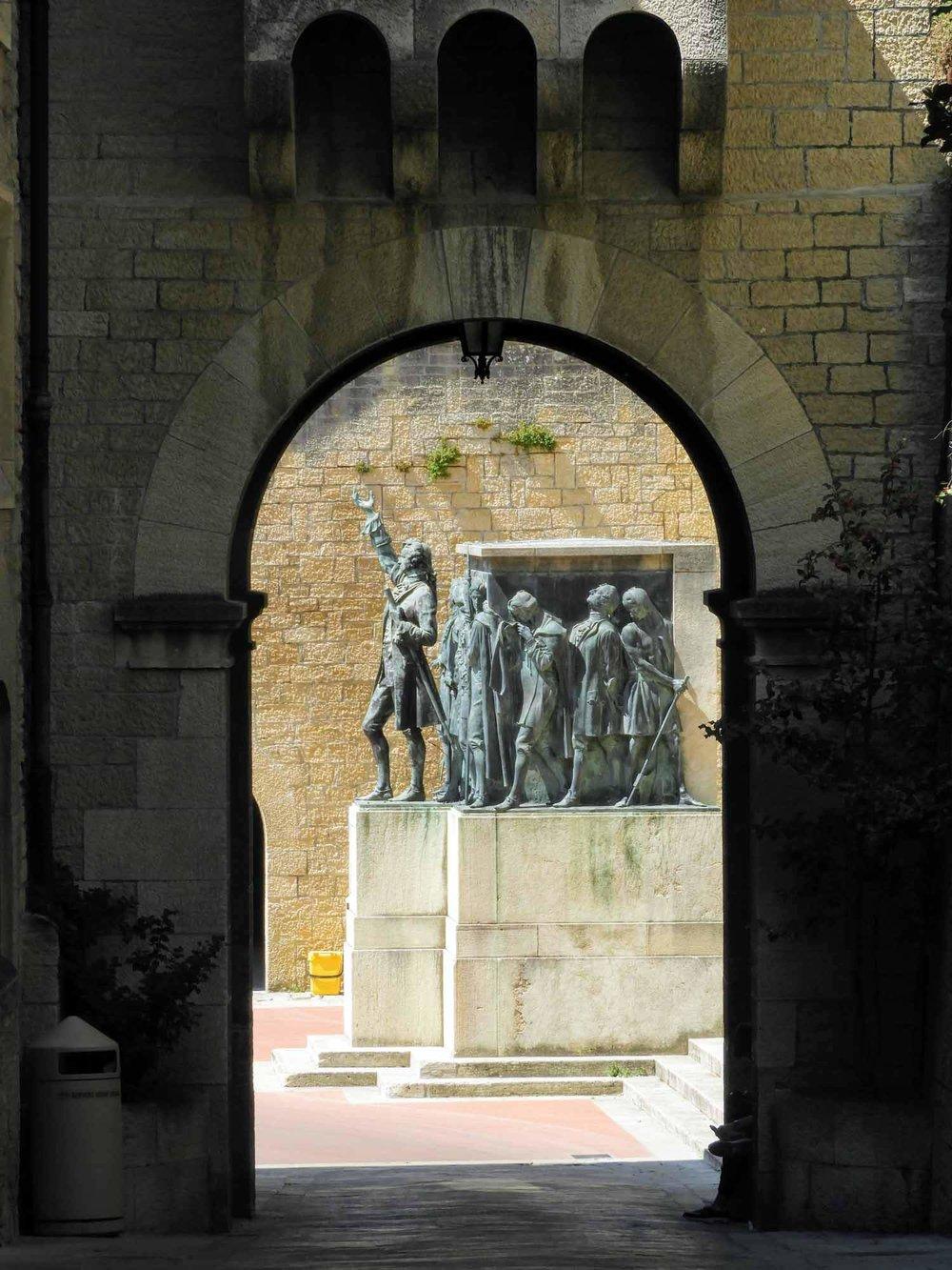 san-marino-micro-nation-ancient-wall-portal-doorway-statue.jpg