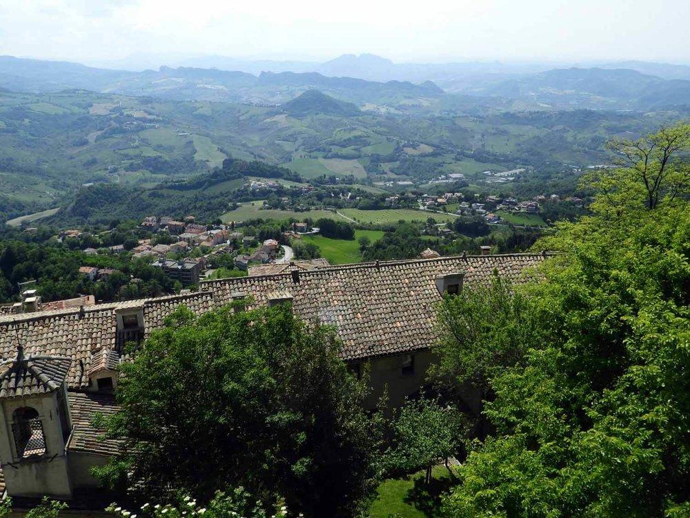 san-marino-micro-nation-green-hills-stone-buildings.jpg