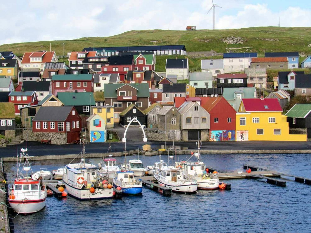 denmark-faroe-islands-nolsoy-village-cartoon-whale-bone-harbor-boats-colorful-houses.jpg