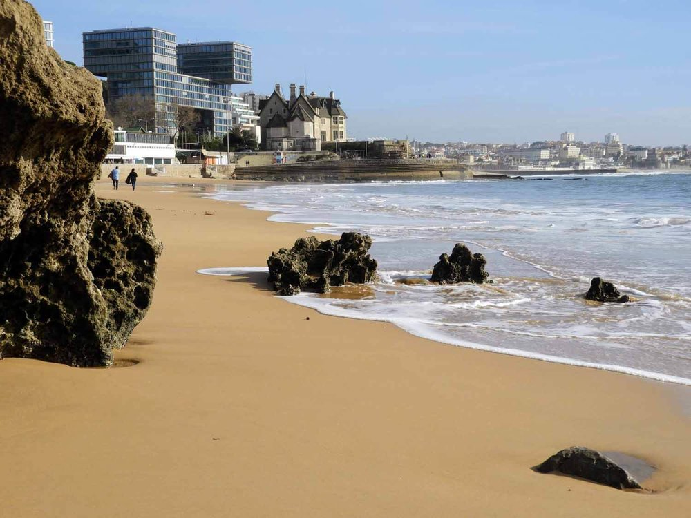 portugal-cascais-sandy-beach-modern-buildings.jpg