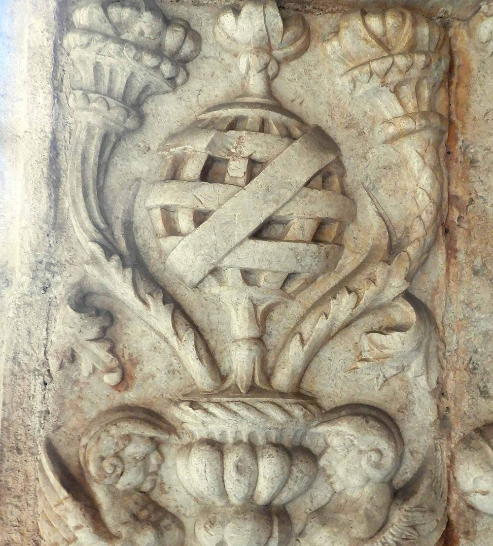 Estilo Manuelino  - The Manuline Style of the 16th Century is one of the most iconic and influential architectural designs in Portuguese history. The style drew heavily from maritime motifs including nautical navigation and sailing equipment, and maritime wildlife and motifs. The Belém Tower & Monastery of Jerónimos are two of the premier Manueline examples in the country.Armillary Sphere shown here is navigation tool used along with celestial navigation by early sailors on the open ocean. It allowed the Portugues explorers to sail the open ocean  reaching India, China and the Americas. It is a common part Manueline design and can be seen in the period and modern Portuguese architecture and design. FUN FACT: The Armillary Sphere is also displayed on the Portuguese Flag.