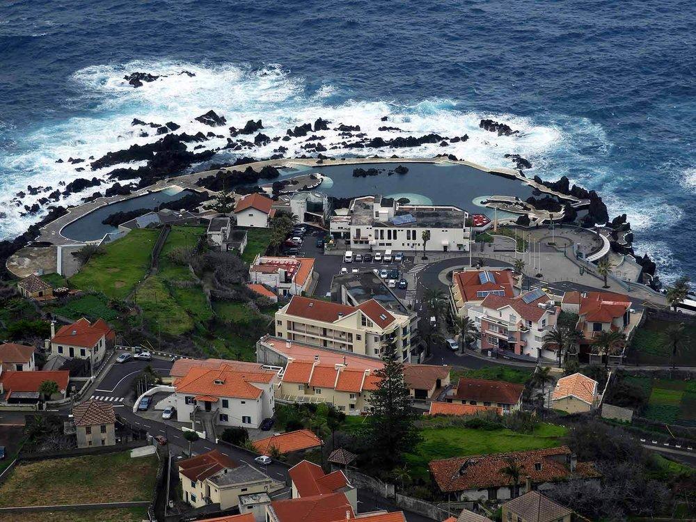 portugal-madeira-island-porto-muniz-north-side-natural-swimming-pool-ocean-sea-shore-town.JPG