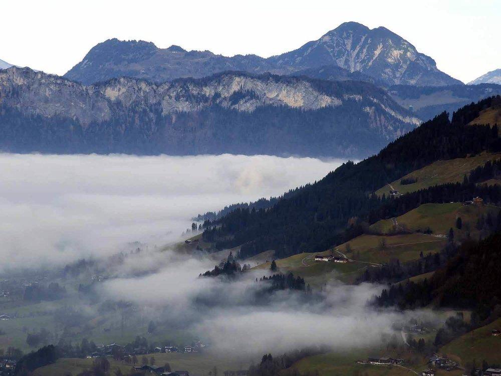 austria-kitzbuhel-alps-foggy-valley.JPG