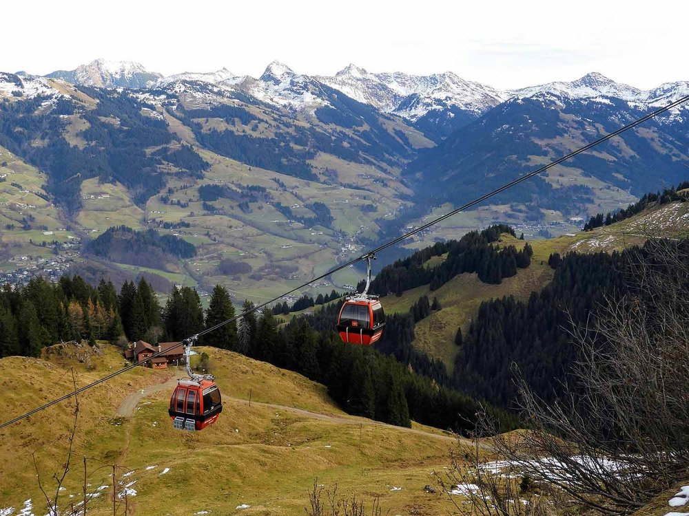 austria-kitzbuhel-alps-cable-car-resort-piste.JPG