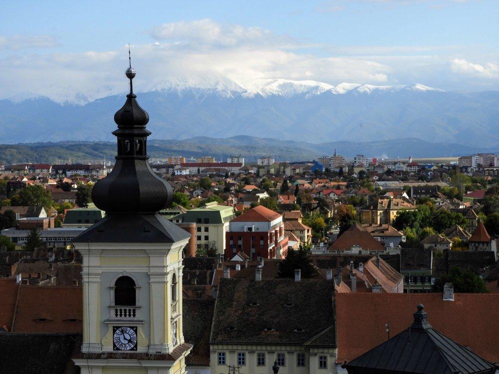 romania-sibiu-church-tower-mountains-snow.JPG