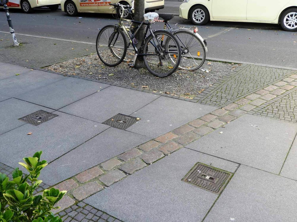 germany-berlin-wall-cold-war-soviet-union-west-vs-east-stone-marking-bikes.jpg