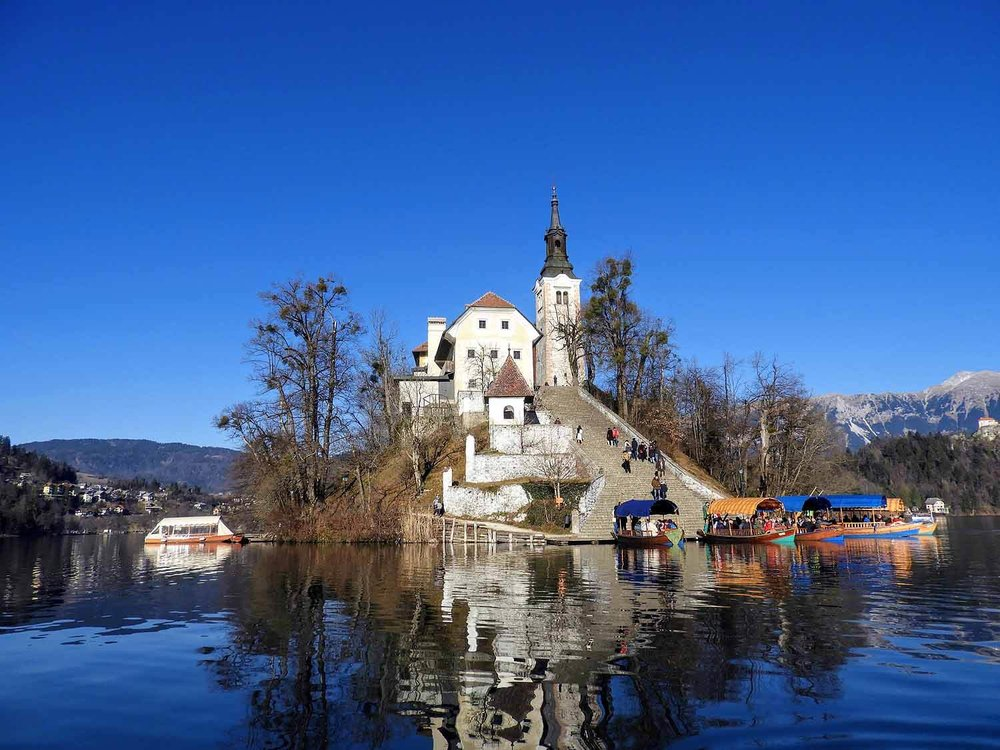 slovenia-lake-bled-pilgrimage-church-assumption-maria-island-monk.jpg