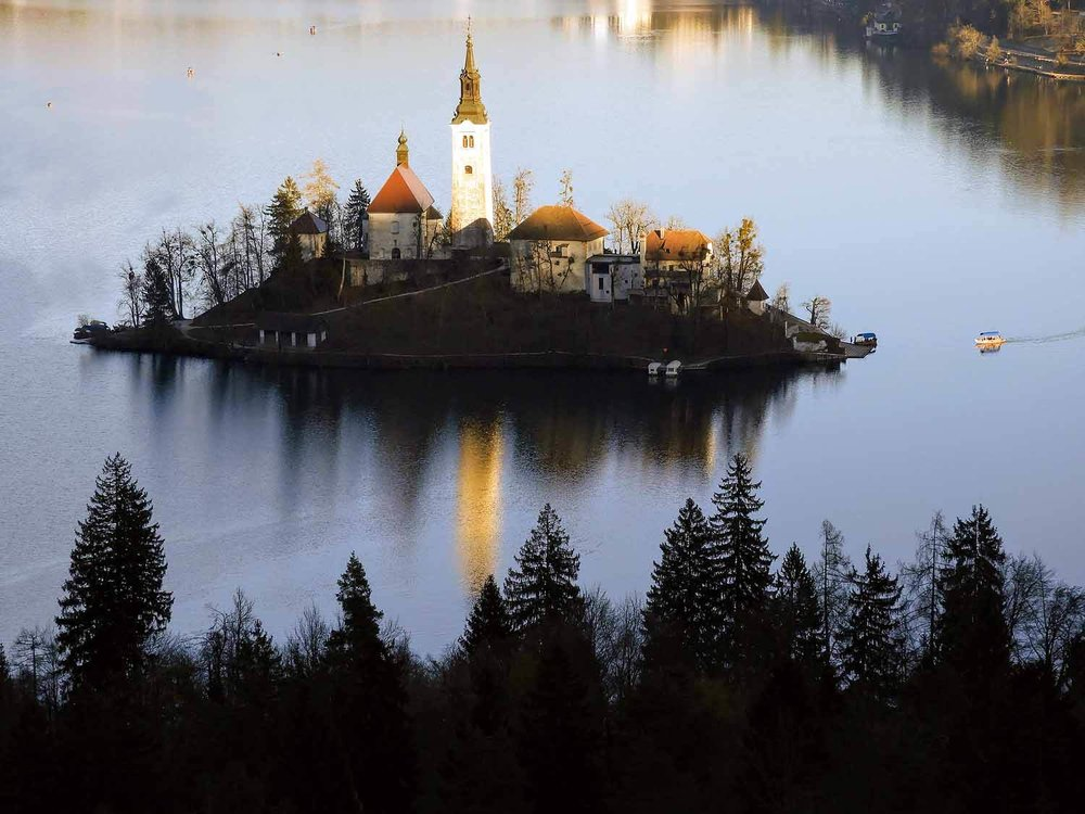 slovenia-lake-bled-pilgrimage-church-assumption-maria-sunset.jpg