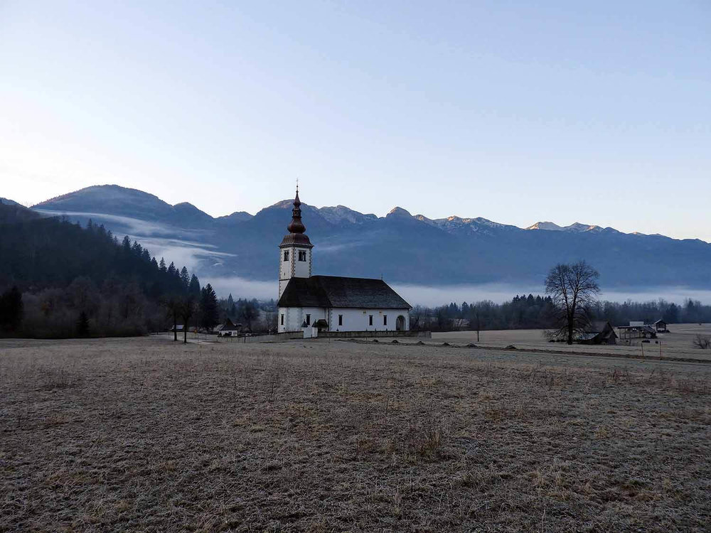 slovenia-triglav-national-park-foggy-morning-church.jpg