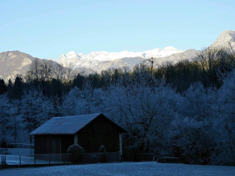slovenia-triglav-national-park-mountains-winter-barn-snow-frozen.jpg