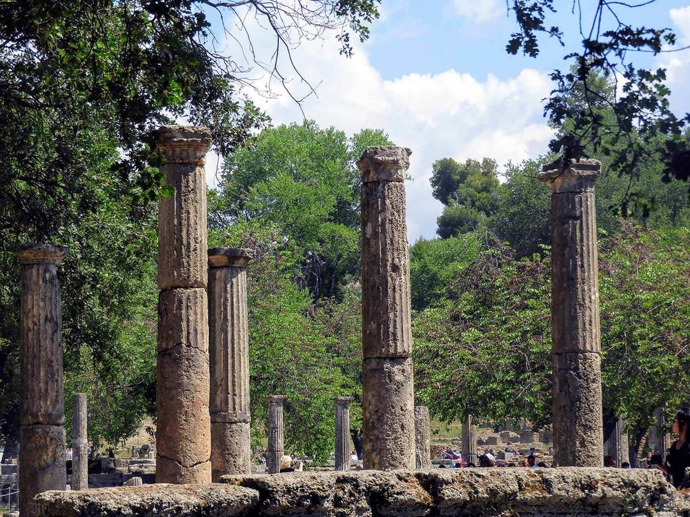 greece-olympia-ruins-olympic-columns-trees.jpg
