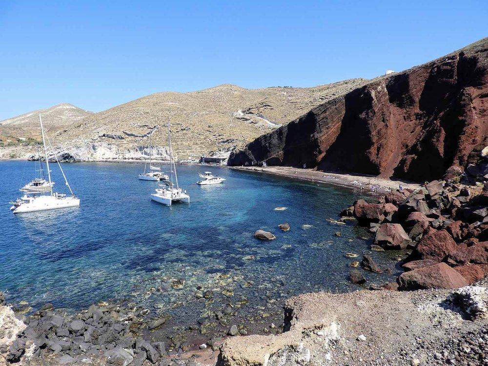 greece-santorini-red-beach-greek-sailboat.jpg