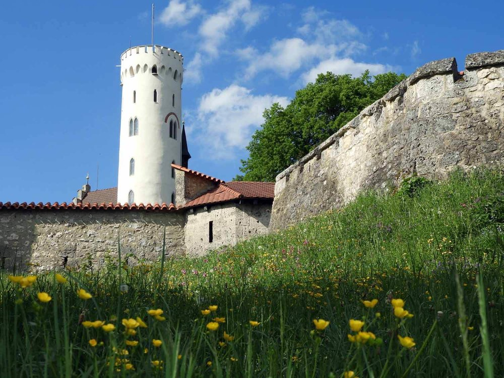 germany-schloss-lichtenstein-tower-walls-flowers.JPG