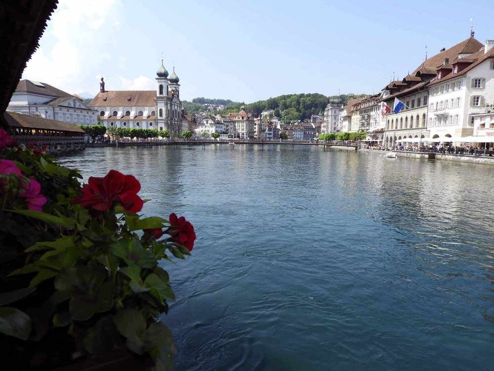 switzerland-lucerne-chaple-bridge-flowers-river-cross.JPG