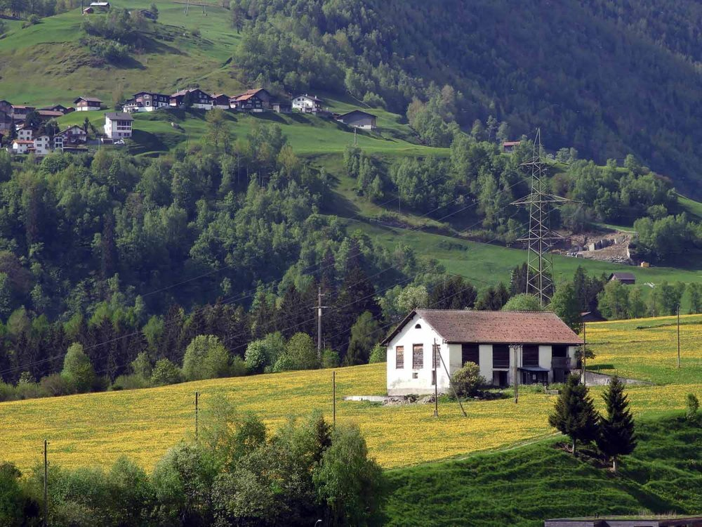 switzerland-oberalppass-vorderrhein-river-valley-farm.JPG