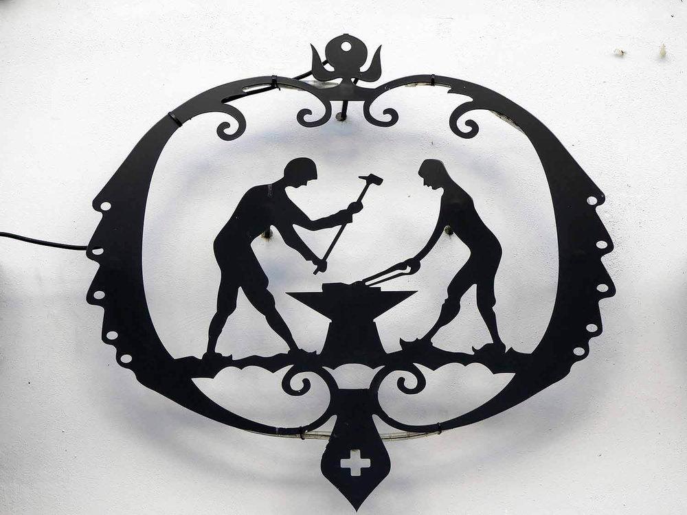 switzerland-neuchatel-blacksmith-sign.JPG