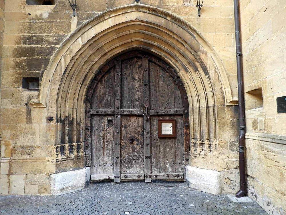 switzerland-neuchatel-collégiale-reformed-church-wood-doors.JPG