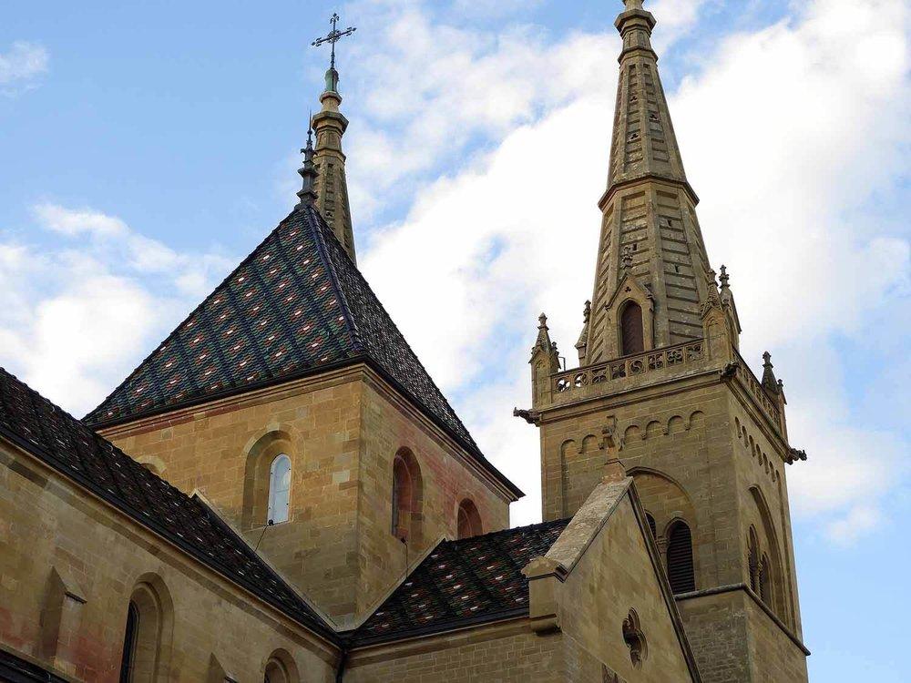 switzerland-neuchatel-collégiale-reformed-church-spires.JPG