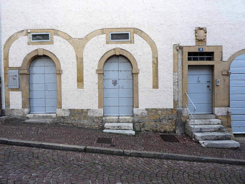 switzerland-neuchatel-steep-street-doors.JPG
