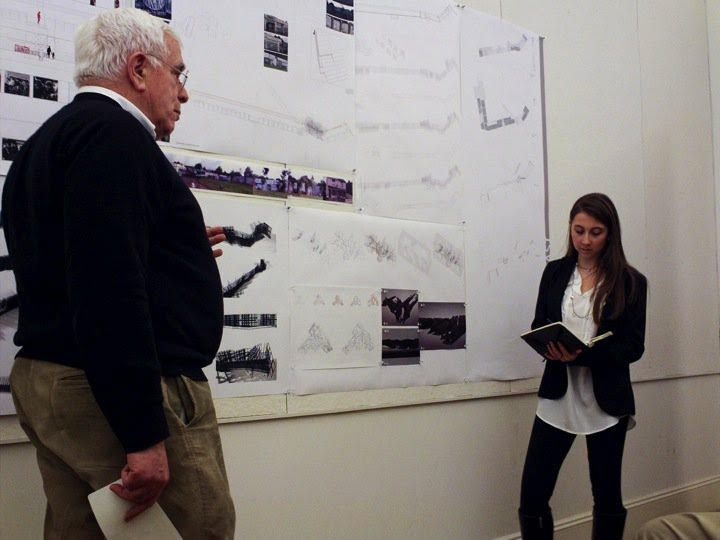 Irina (right) presenting to Peter Eisenman (left) during graduate school. Photo courtesy of Cornell University