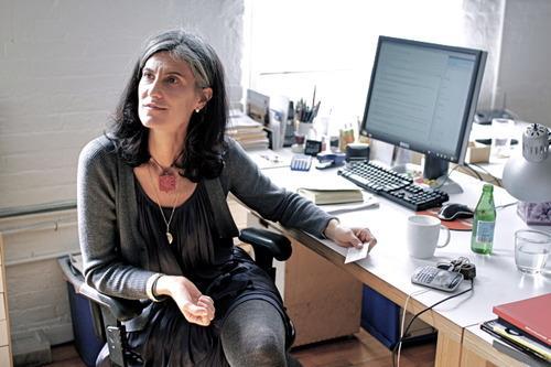 Galia at her Solomonoff Architecture Studio's desk, 2013.