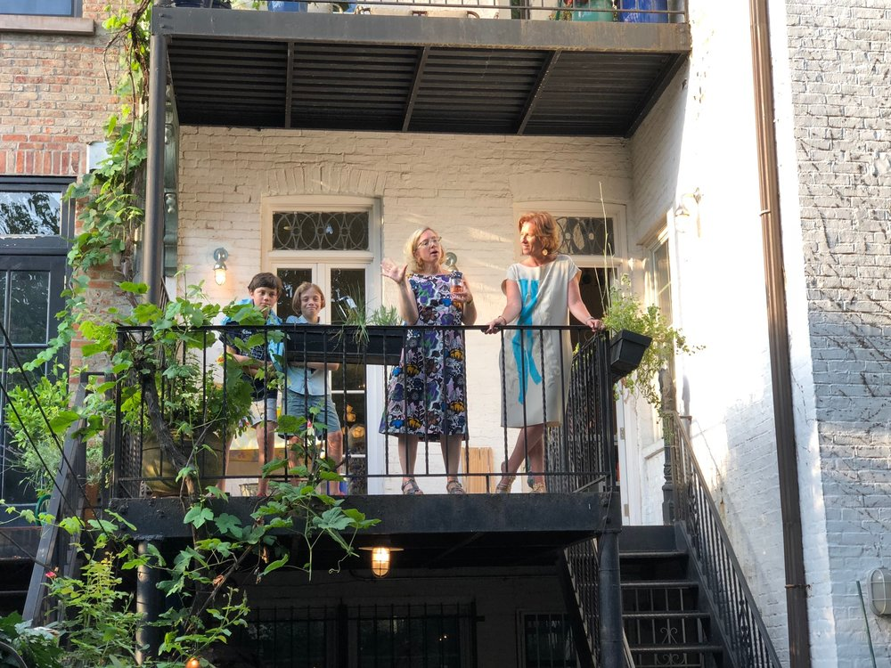 Lange at her book party in Brooklyn in July, wearing Marimekko x Uniqlo, with Leslie Koch at right, and her son and a friend at left. (Photo credit Aaron Naparstek)