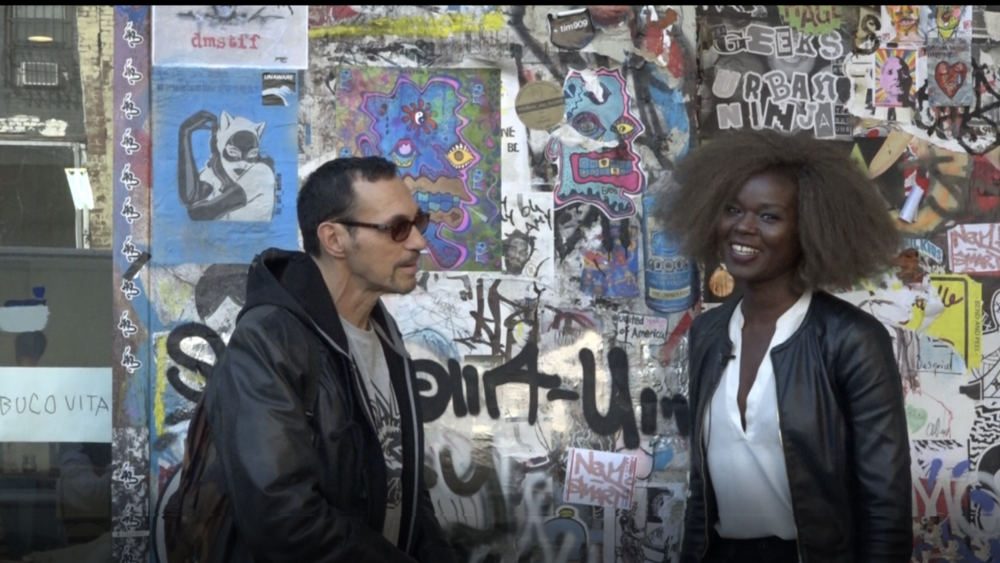 Amina on set as host of Architecture Speaks documentary with guest graffiti artist, Al Diaz