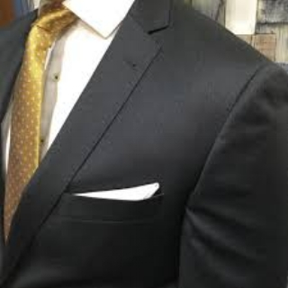 Charcoal mens suit with gold tie