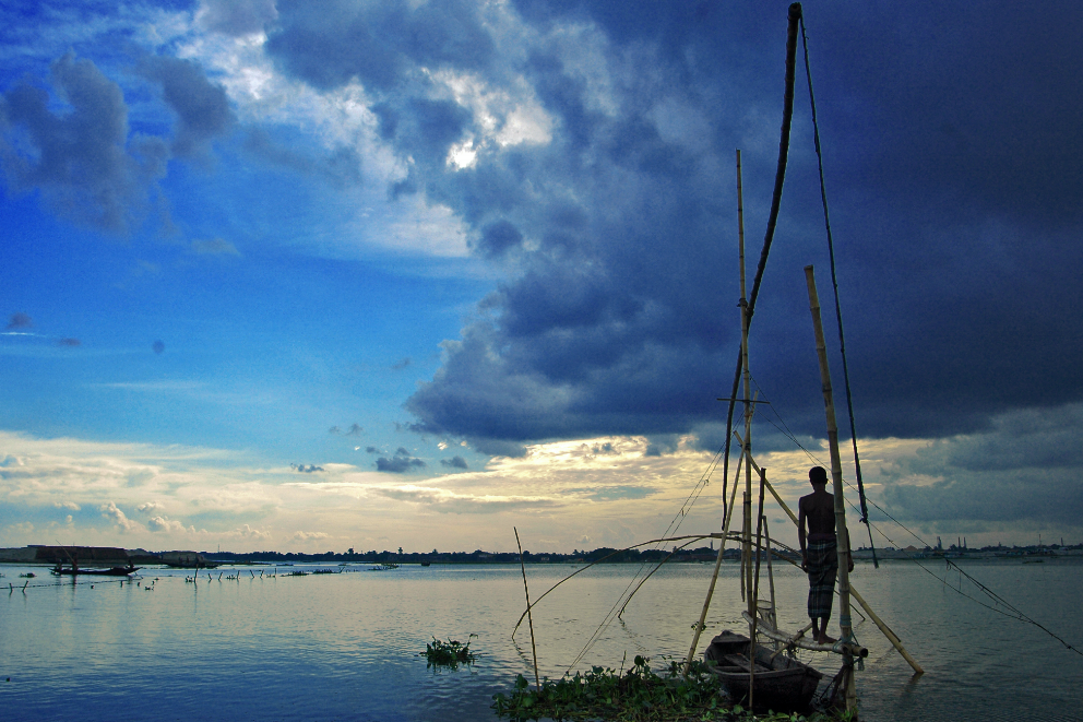 Fisherman at Dusk, Bangladesh CREDIT: MOHAMMAD RAKIBUL HASAN / coral reef image bank