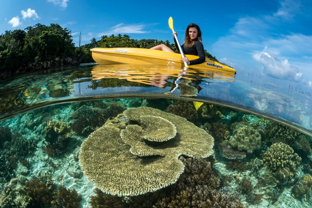 a kayaker in raja ampat CREDIT: FABRICE DUDENHOFER / coral reef image bank