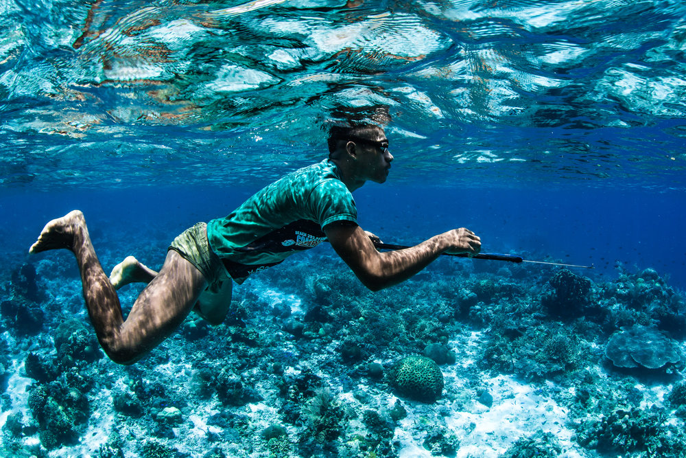 06 - a fisherman looking for the day's catch credit: erik lukas / coral reef image bank