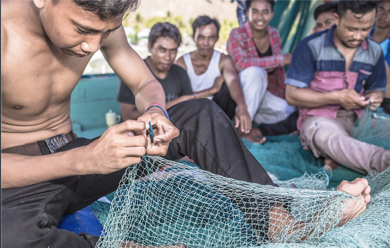 fisherman mending lines in indonesia credit: Martin Colognoli / coral reef image bank
