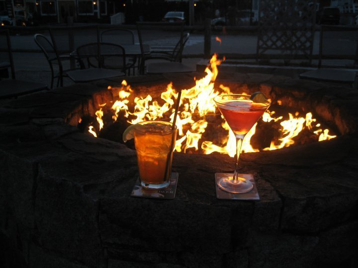 Fire pit patio - Like a beacon of light on a dark night. We are well known for being one of, if not, the first around to have a large fire pit. Whether it's a crisp night in the Spring or Fall, a Snow Storm in the middle of Winter or 95 degrees in the Summer our Fire Pit is on whenever we are open. Join us for some food or a cocktail by the Fire Pit, see you soon!
