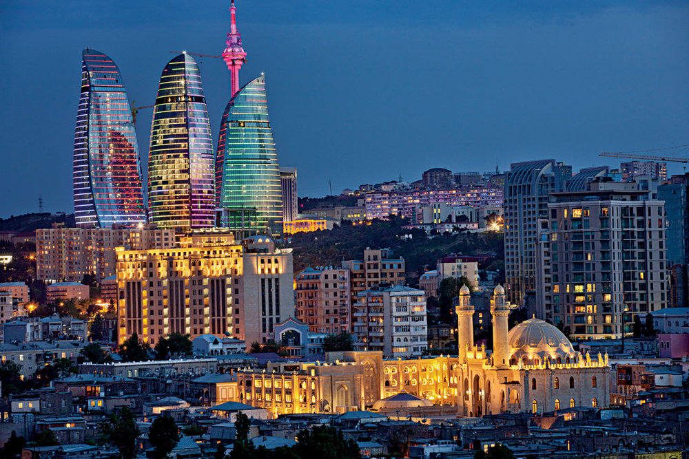 A view of Baku at night & the Flame Towers.