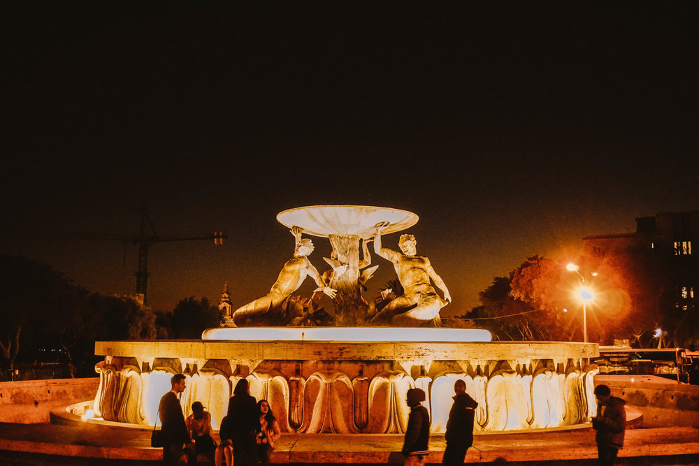The Triton Fountain    was constructed in 1959 by a Maltese sculptor who won the national competition for designing a fountain to decorate the main city bus station (where it sits today).