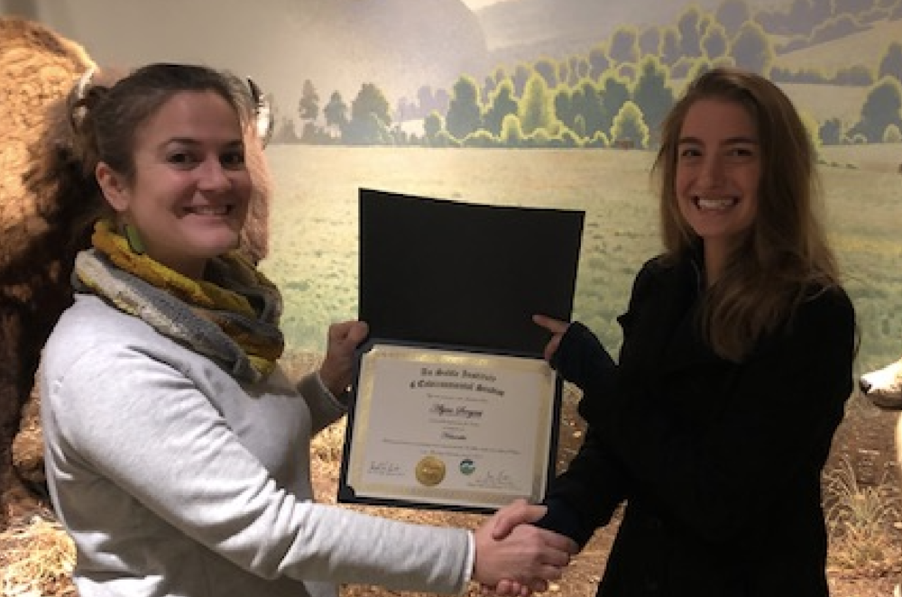 Helena Cicero (left) presents the certificate to Alyssa Sargent (right).