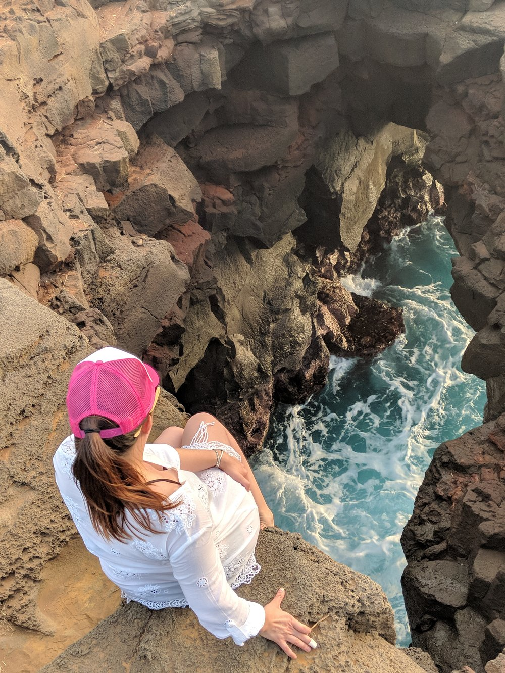 If you are feeling particularly adventurous you can jump off the cliffs and swim through the sea cave and climb up the opening pictured above.