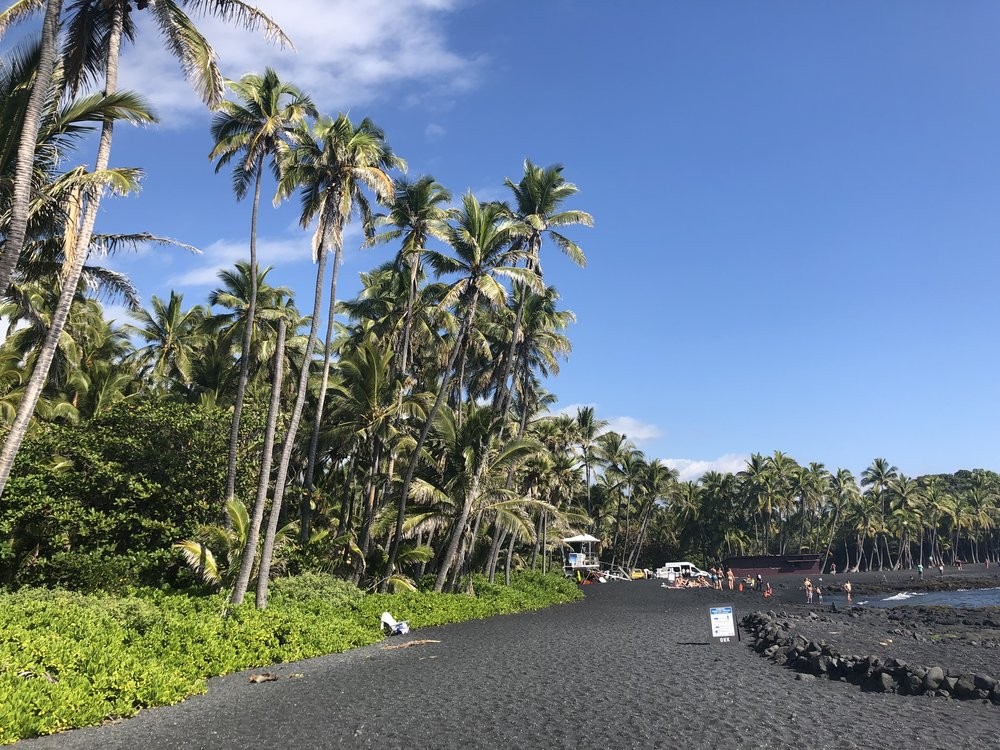 View of Black Sand Beach Punalu'u can sometimes get crowded as tour busses drop of dozens of people at a time.
