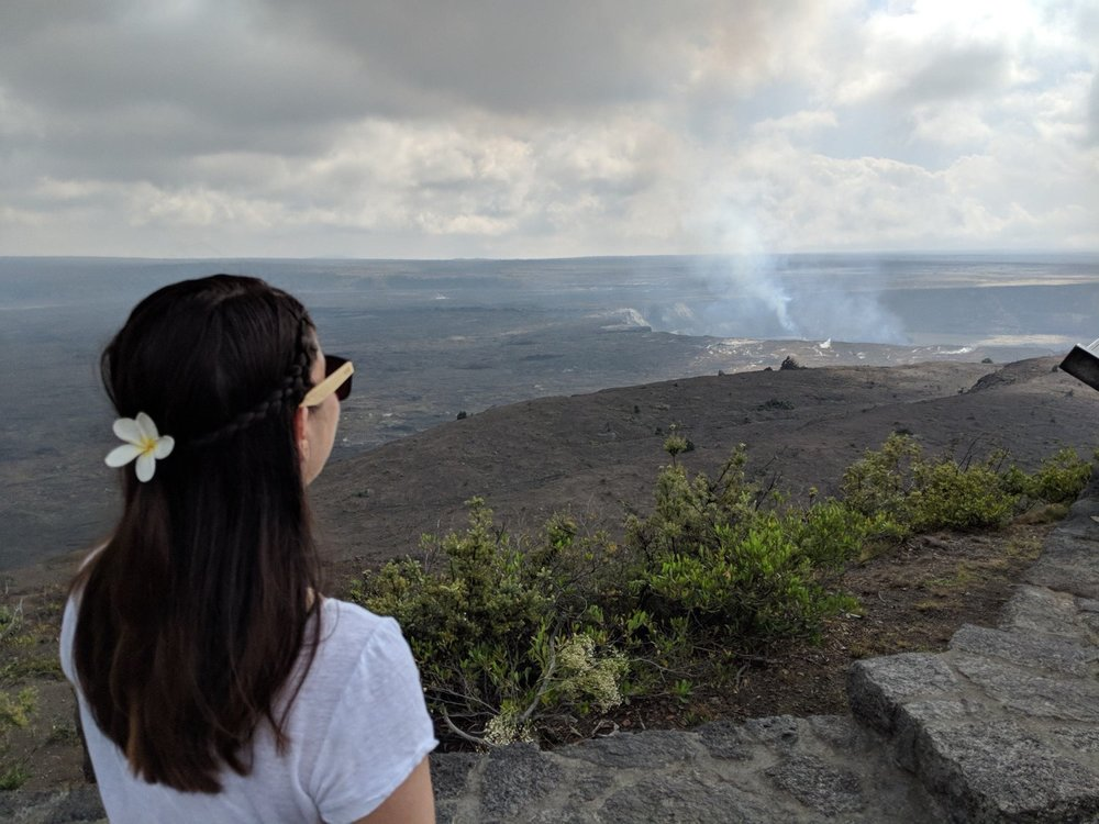 girl staring out at Volcanos National Park, Hawaii.
