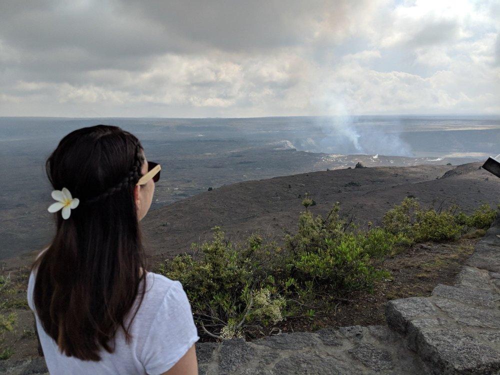 girl staring out at Volcanos National Park, Hawaii.
