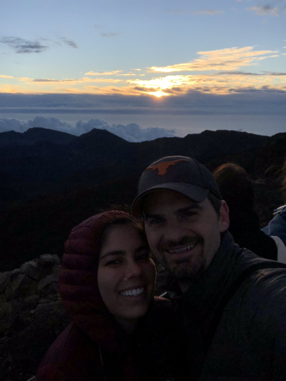 Couple bundles up to make it to sunrise at Haleakala Crater in Maui, Hawaii