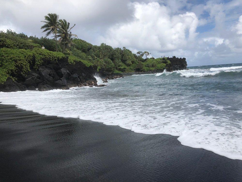 Black sand beach at the Wai'napanapa State Park, Maui.