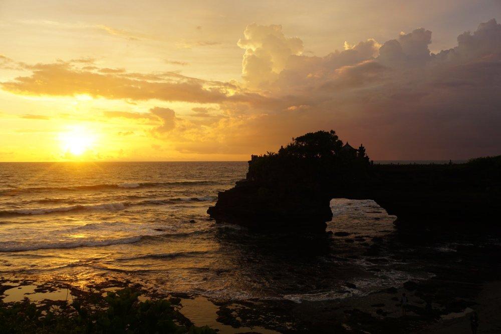 Tanah Lot sea arch at sunset in Changgu, Bali.