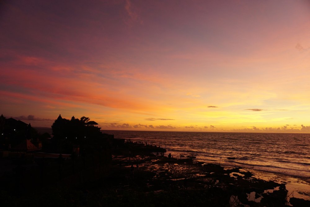 Tanah Lot low tide at sunset in Bali.