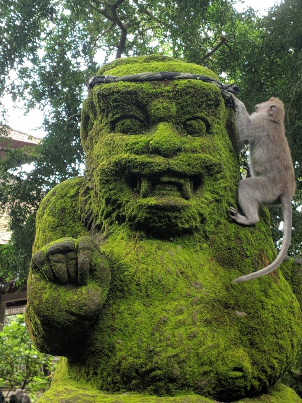 Monkeys crawl on Monkey statues in the Monkey Forest of Ubud, Bali. boldlygotravel.com