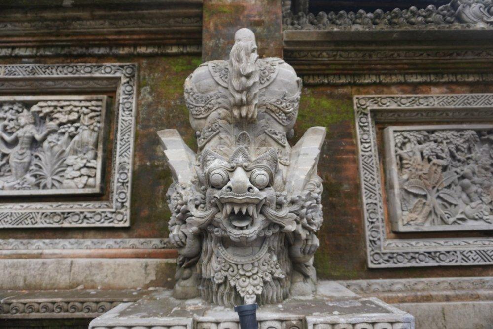 Stone caving at a temple in Ubud, Bali. Boldlygotravel.com