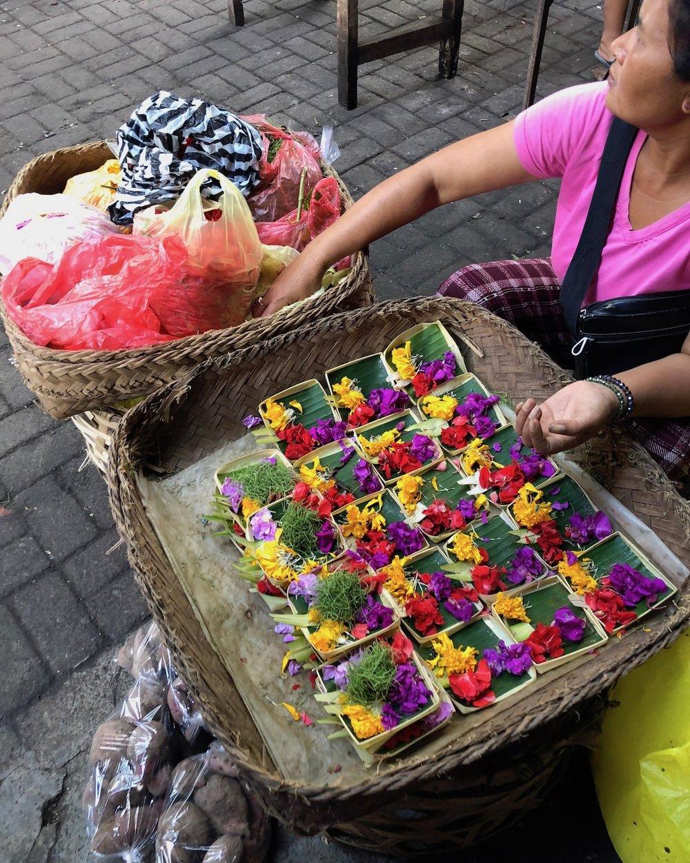 Colorful offerings sold at the Ubud Market, Bali. boldlygotravel.com