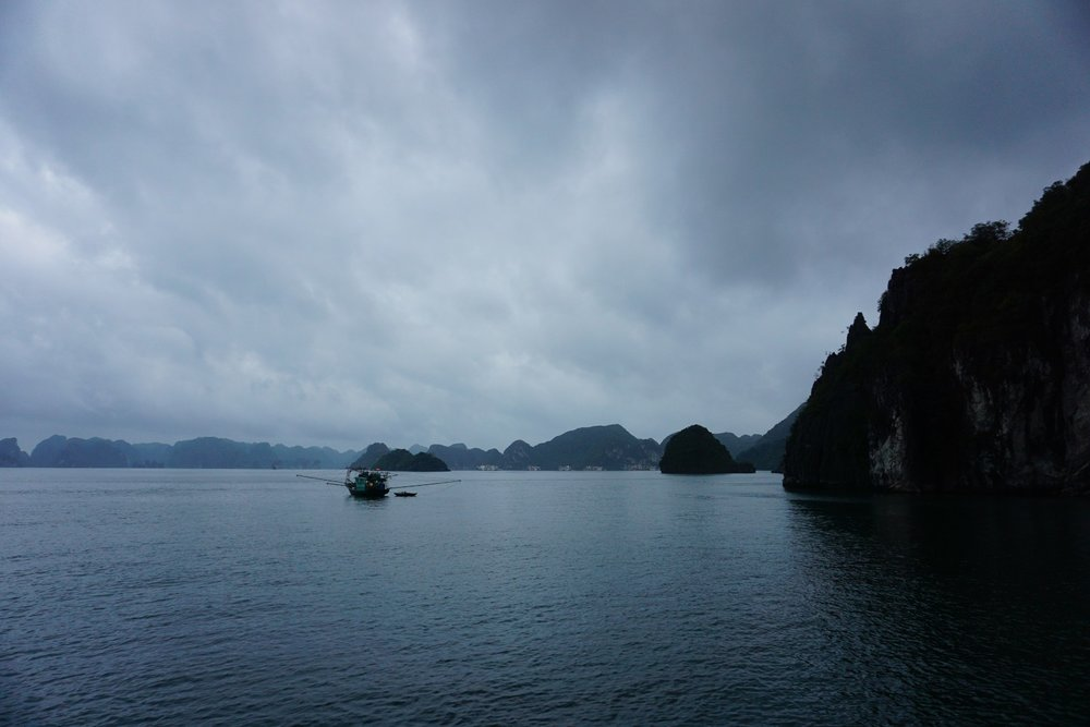 A dark and overcast morning in Ha Long Bay, Vietnam. boldlygotravel.com