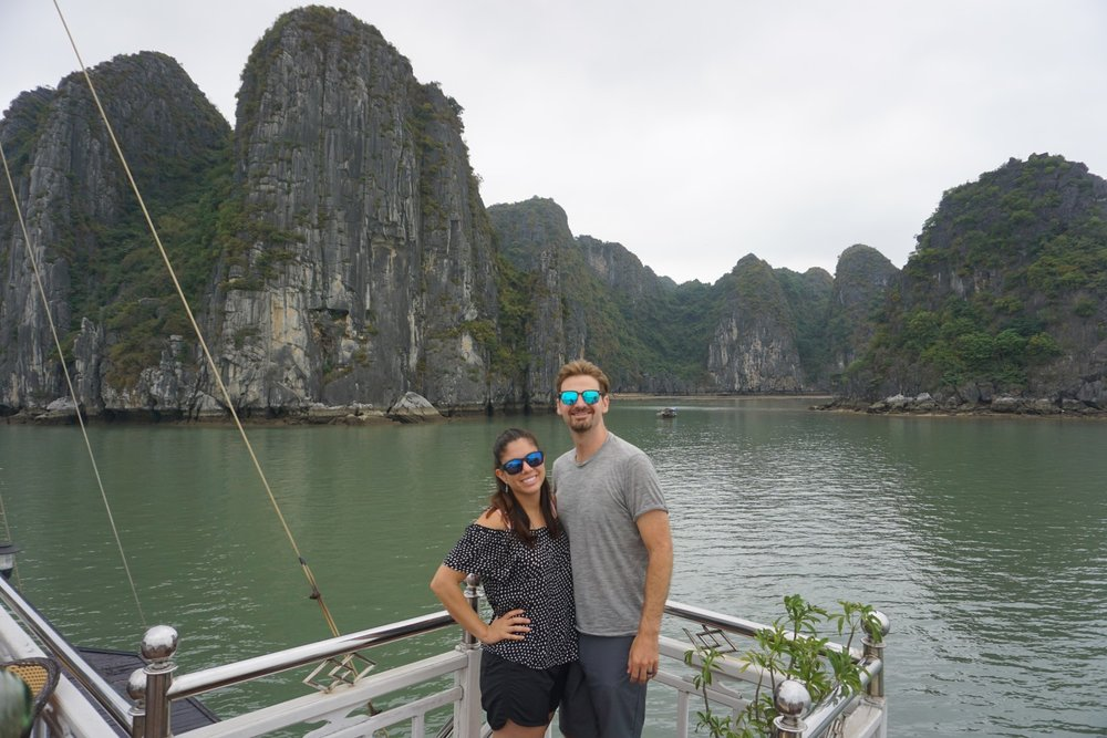 Couple enjoys their turbulent trip to Ha Long Bay the gem of Vietnam and UNESCO World Heritage Site. boldlygotravel.com